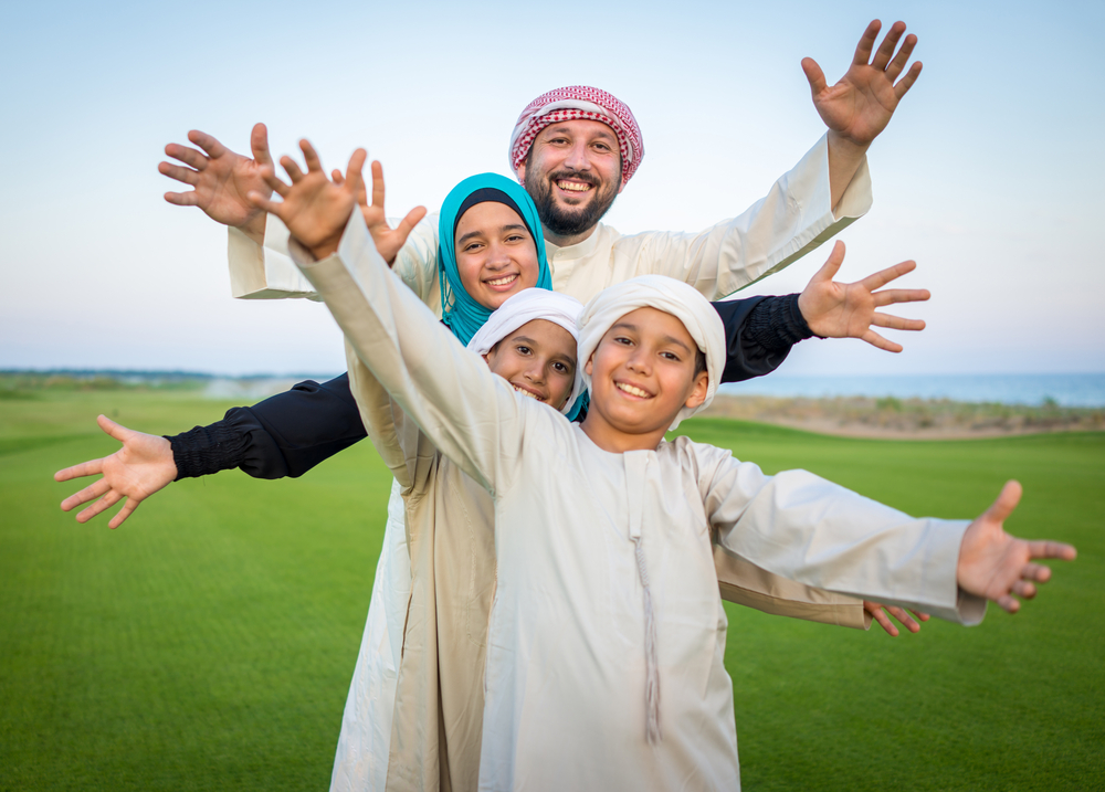 Arabic family on green meadow in nature-1