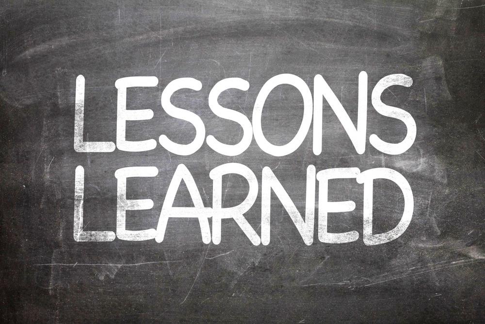 Lessons Learned written on a chalkboard