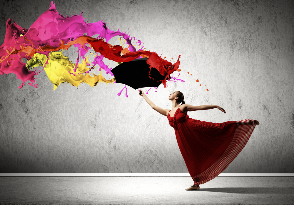 ballet dancer in flying satin dress with umbrella under the paint