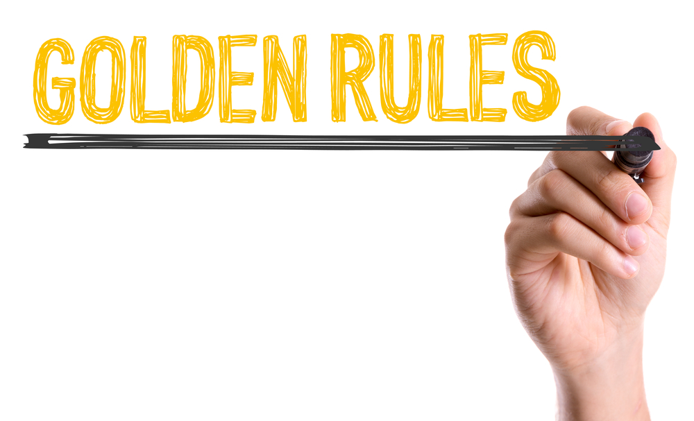 Hand with marker writing Golden Rules